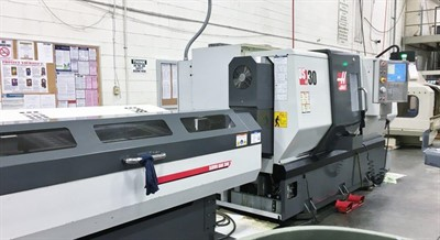 HAAS DS 30 CNC UNIVERSAL TURNING CENTER WITH BARFEED